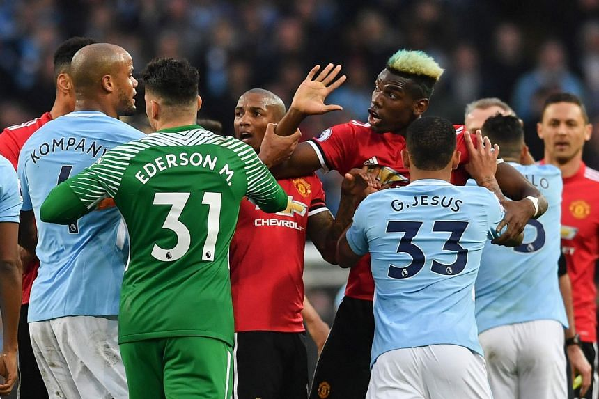 Pogba (second right) clashes with City players after a foul on United's Jesse Lingard by City's Fernandinho.
