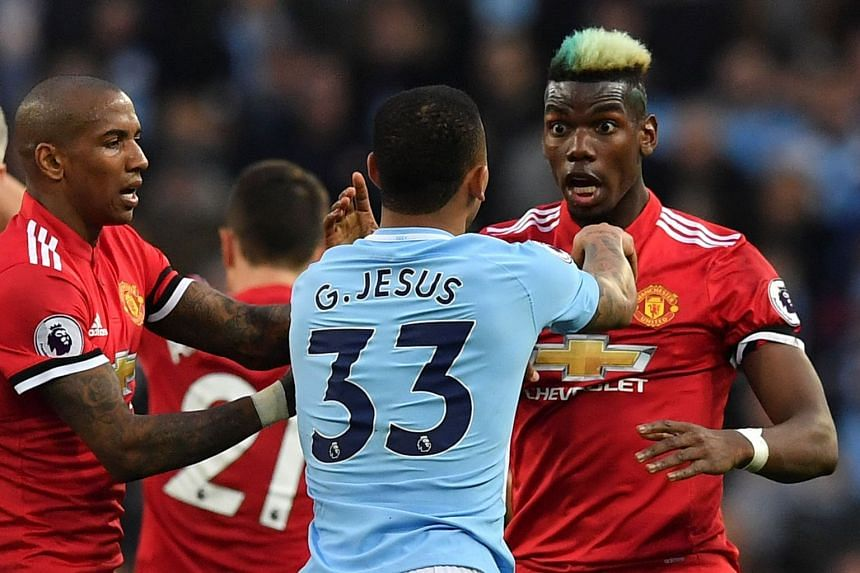 United's Paul Pogba (right) clashes with City's Gabriel Jesus after a foul on Jesse Lingard by City midfielder Fernandinho.