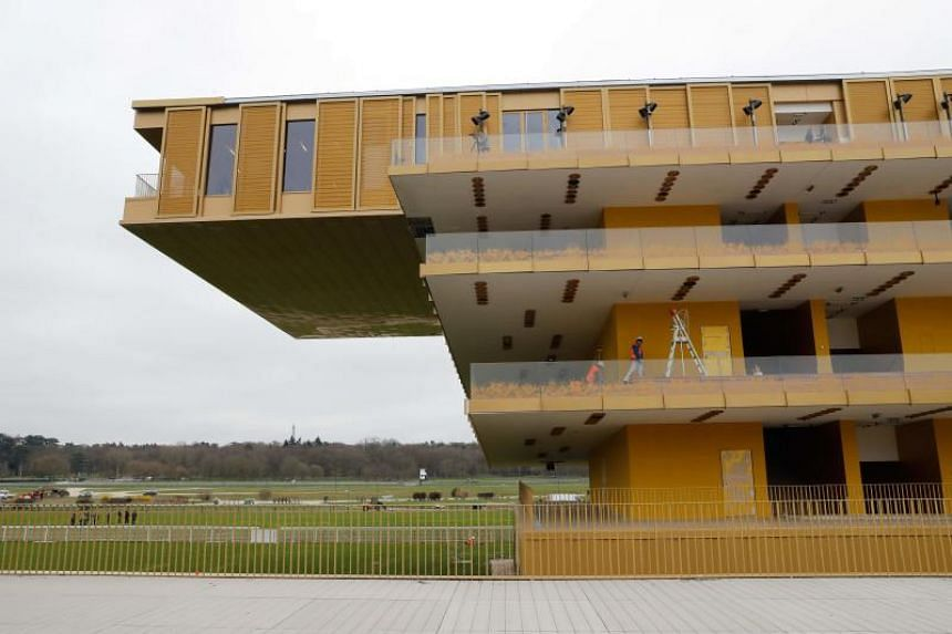 The new Hippodrome ParisLongchamp horse-racing facility, designed by French architect Dominique Perrault, at the Bois de Boulogne in Paris on March 22, 2018.