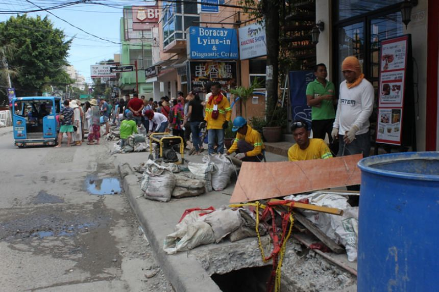 Work being carried out on the drainage system in the business centre on Boracay island, Philippines, on April 6, 2018.