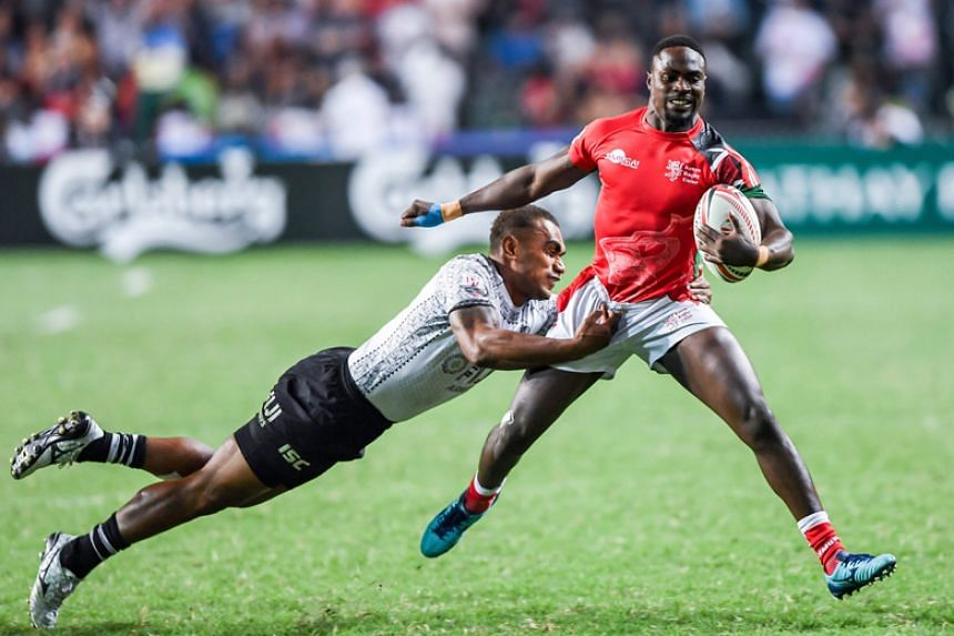 Eroni Sau of Fiji tries to tackle Nelson Oyoo of Kenya during the cup final of the Hong Kong Sevens rugby tournament on April 8, 2018.