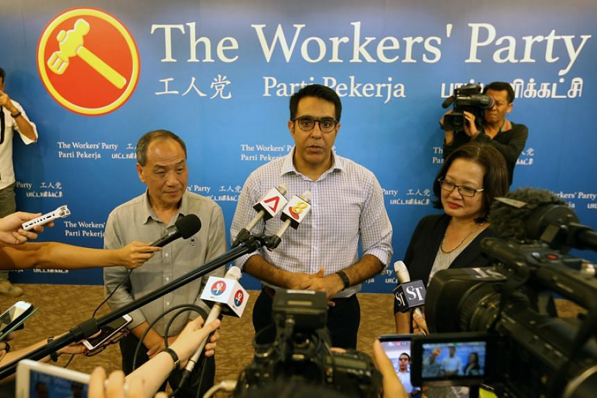 Former Workers' Party chief Low Thia Khiang, new party chief Pritam Singh and party chairman Sylvia Lim speak to the media after the party's biennial conference on April 8, 2018.