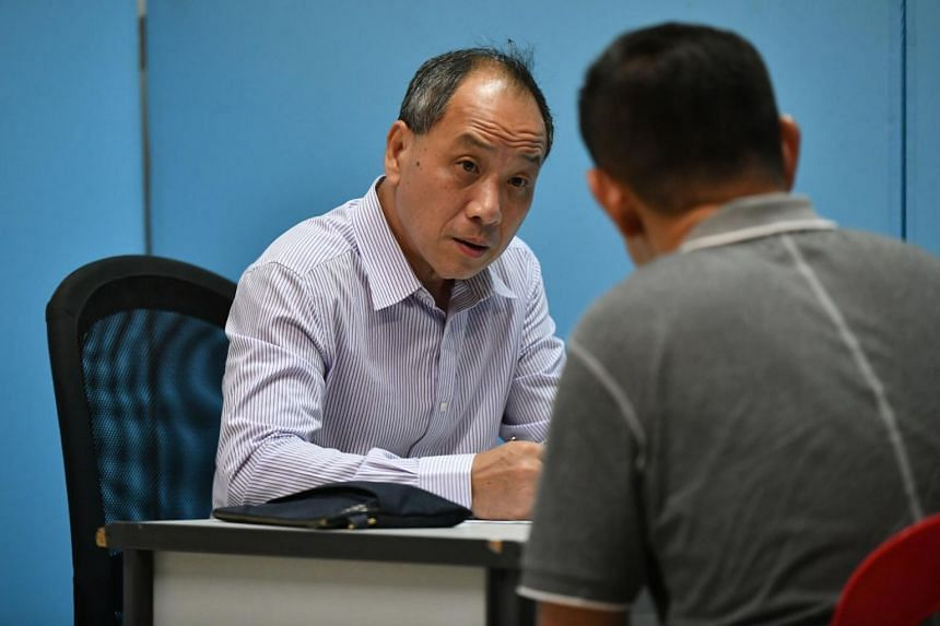 Low Thia Khiang at his last Meet the People Session as Secretary-General of Workers' Party, at the void deck of Blk 522 Hougang Ave 6, on Apr 4, 2018.