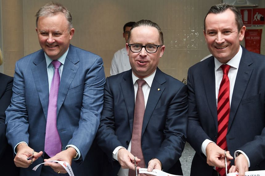 Qantas chief executive Alan Joyce, flanked by politician Anthony Albanese (far left) and Western Australian Premier Mark McGowan, opening the new transit lounge at Perth Airport before the inaugural Qantas flight from Perth to London last month.