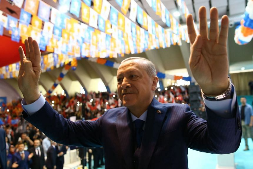 Erdogan waving to  Justice and Development Party members during a meeting in western Turkey on April , 2018.