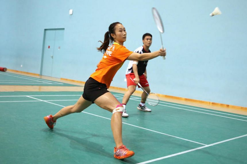 Singapore national badminton team's Terry Hee (right) and Tan Wei Han preparing for their upcoming matches.
