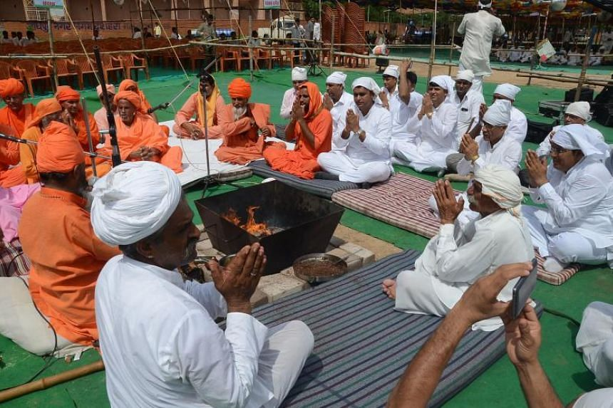 Members of the Bishnoi community offer prayers before taking part in a silent rally against a high court's decision on the acquittal of Bollywood actor Salman Khan from animal poaching cases, in Jodhpur on Aug 12, 2016.
