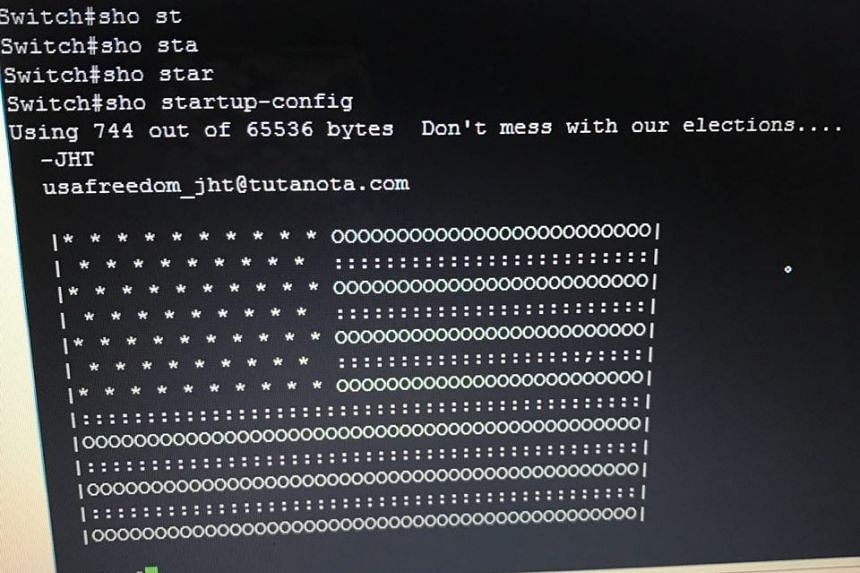 An image posted by Iran's IT Minister Mohammad Javad Azari-Jahromi, showing an image of a US flag that was left on screens by hackers that hit networks in Iran.