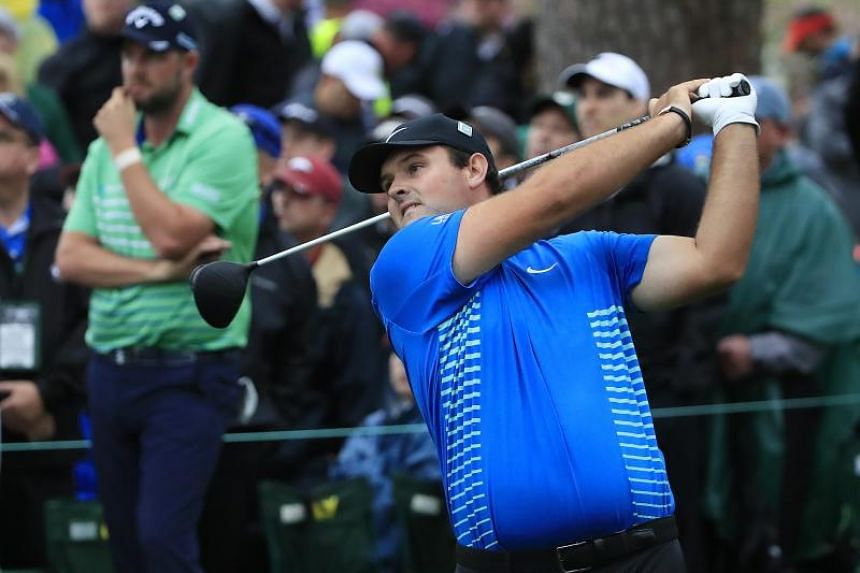 Patrick Reed hits his tee shot on the seventeenth hole during the third round of the 2018 Masters Tournament at the Augusta National Golf Club in Georgia on April 7, 2018.