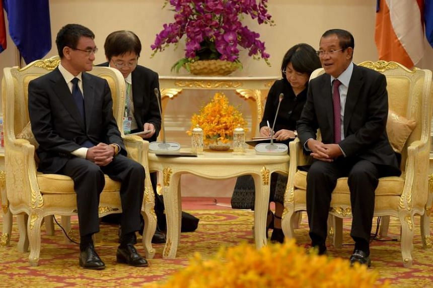 Japan's Foreign Minister Taro Kono meets Cambodia's Prime Minister Hun Sen at the Peace Palace in Phnom Penh on April 8, 2018.