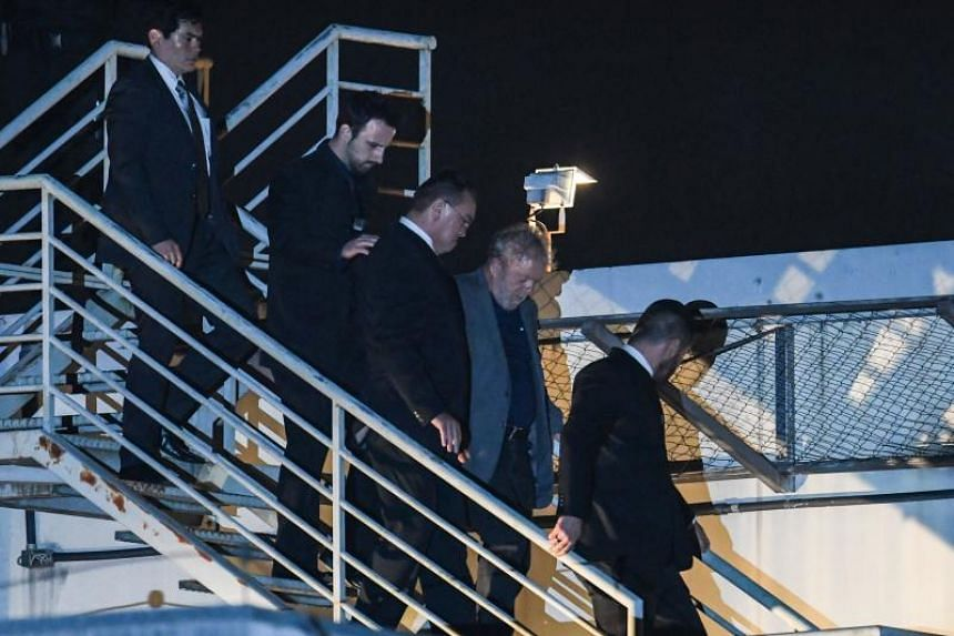 Brazil's ex-president Luiz Inacio Lula da Silva (second from right) arriving at the Federal Police headquarters where he is due to serve his 12-year prison sentence, in Curitiba, Parana State, Brazil, on April 7, 2018.
