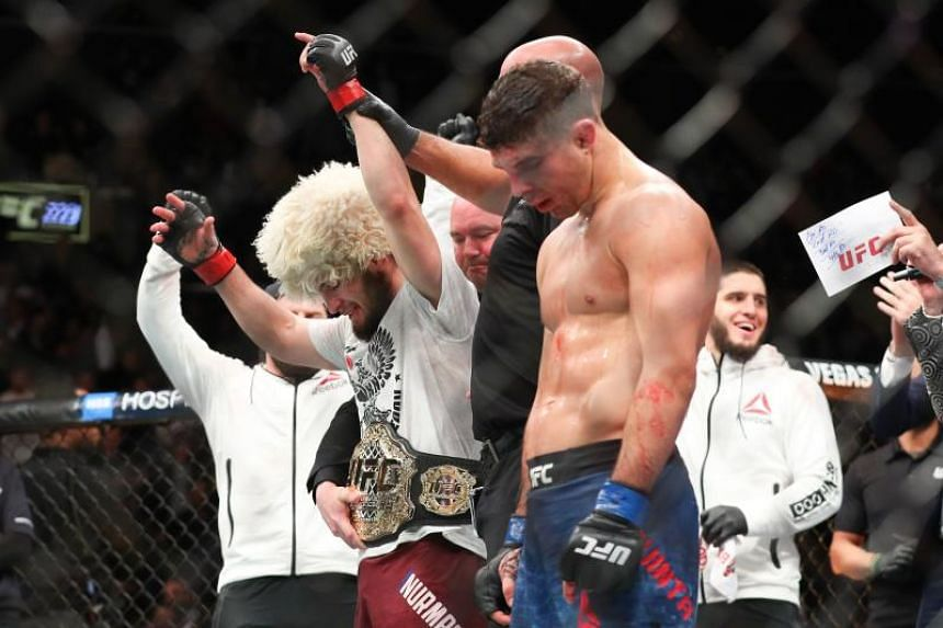 Khabib Nurmagomedov (left) celebrates his win over Al Iaquinta to capture the UFC lightweight championship at UFC 223 at Barclays Center in New York City on April 7, 2018.