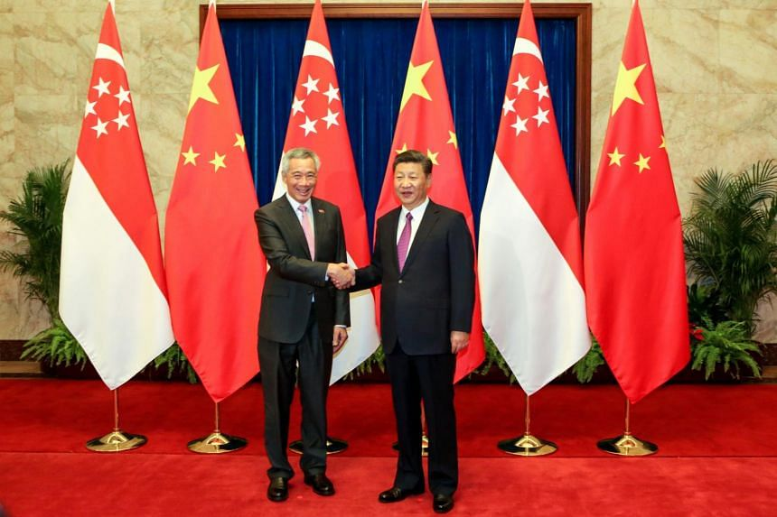 File photo showing Singapore Prime Minister Lee Hsien Loong shaking hands with Chinese President Xi Jinping at the Great Hall of the People in Beijing, China, on Sept 20, 2017.