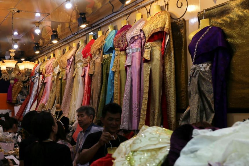 Racks of Thai historical clothing line a shop in Bangkok, as interest in traditional garments rise.