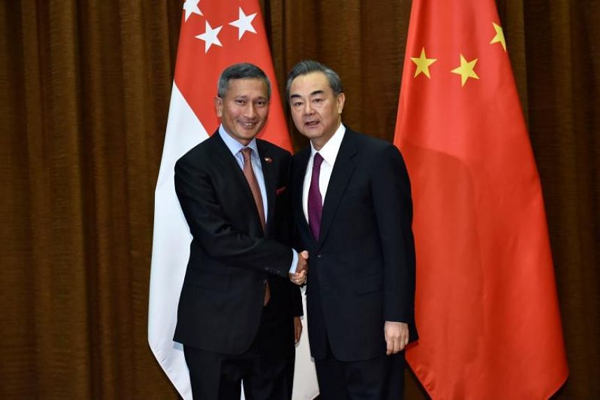 Minister for Foreign Affairs Vivian Balakrishnan (left) shakes hands with his Chinese counterpart Wang Yi before their meeting at the Ministry of Foreign Affairs in Beijing on April 8, 2018.