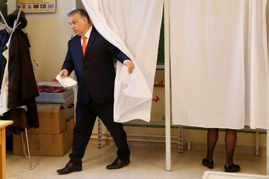 Hungarian Prime Minister Viktor Orban leaves a polling booth to cast his ballot during the parliamentary election in Budapest on April 8, 2018.