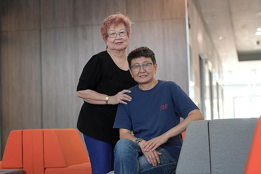Ms Chan Yoke (seated) with her mother Lina Toh, 74. Ms Chan, who completed chemotherapy two years ago, still finds it hard to focus and becomes tired easily.