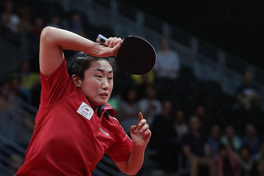 Feng Tianwei enduring a tough time against Manika Batra in the opening match. The Indian's shock win boosted her team's confidence.