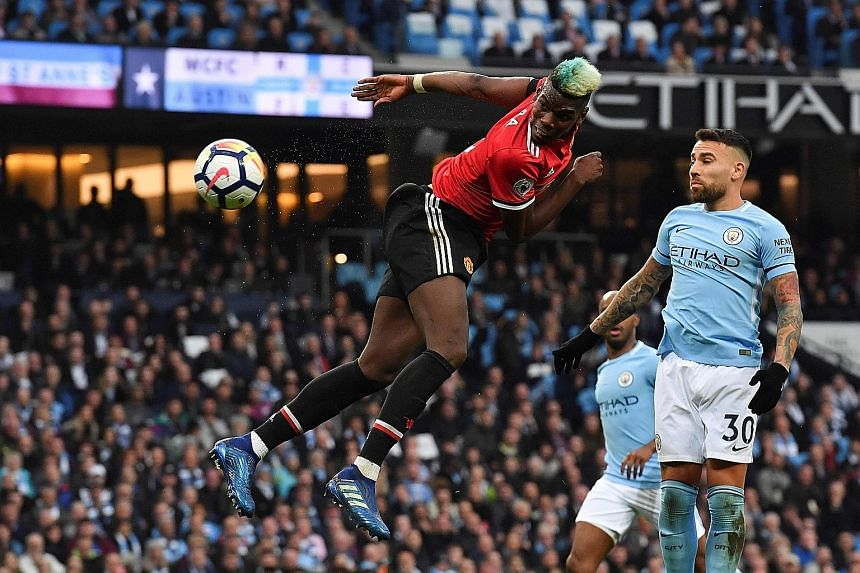 Paul Pogba heading home Manchester United's equaliser against City as Nicolas Otamendi can only look on. Chris Smalling's 69th-minute goal gave United a 3-2 win.