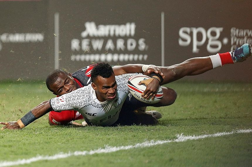 Fiji's Jerry Tuwai being tackled by Kenya's Willy Ambaka during the Hong Kong Sevens Cup final yesterday. Fiji won 24-12 to clinch a record fourth straight sevens title at the Hong Kong Stadium.