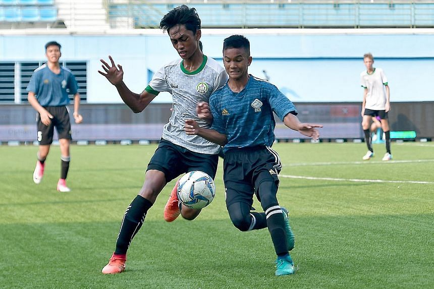 Boon Lay Secondary's Haryzal Abdullah squaring off with Chua Chu Kang Secondary's Rebin Elhan B. Rozzani, 16, in the battle for the West Zone B Division boys' football championship at Jalan Besar Stadium last Wednesday. Chua Chu Kang won 2-1. Boon La