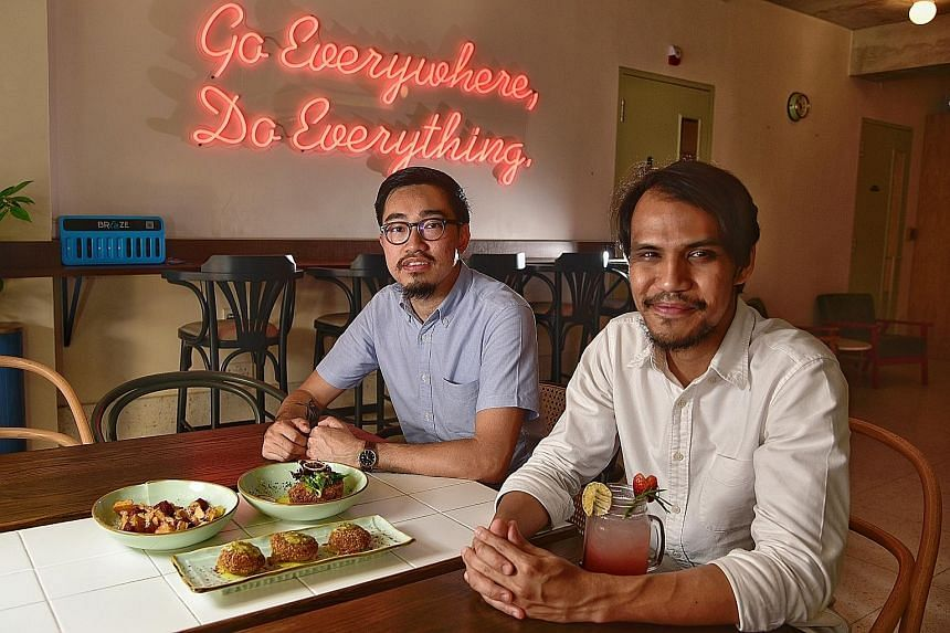 The Black Hole Group founders Calvin Seah (left) and Mustaffa Kamal at their latest restaurant The Great Mischief, which opened in February and serves Catalan-inspired tapas. It is one of five restaurants operated by the group, which focuses on halal