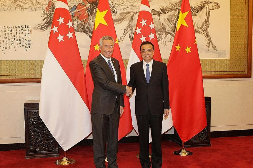 Chinese Premier Li Keqiang greeting Prime Minister Lee Hsien Loong at the Diaoyutai State Guesthouse in Beijing yesterday. PM Lee is on a five-day visit to China starting yesterday.