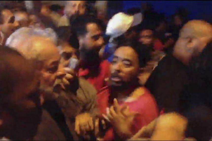 TV grab of Brazilian former President Luiz Inacio Lula da Silva (centre) leaving the Metallurgical Union on his way to Sao Paulo airport, in Sao Bernardo do Campo, Sao Paulo state, Brazil, on April 7, 2018.