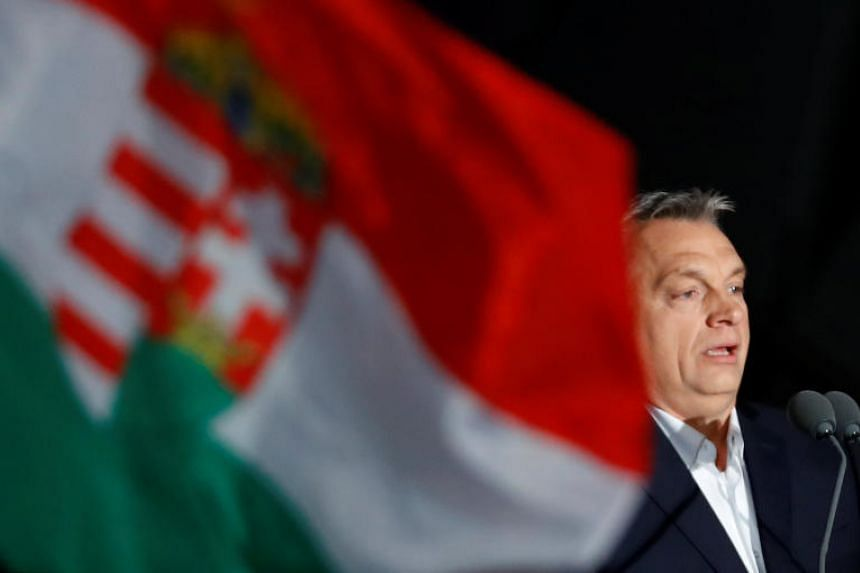 Hungarian Prime Minister Viktor Orban addresses supporters after the announcement of the partial results of parliamentary election in Budapest, Hungary, on April 8, 2018.