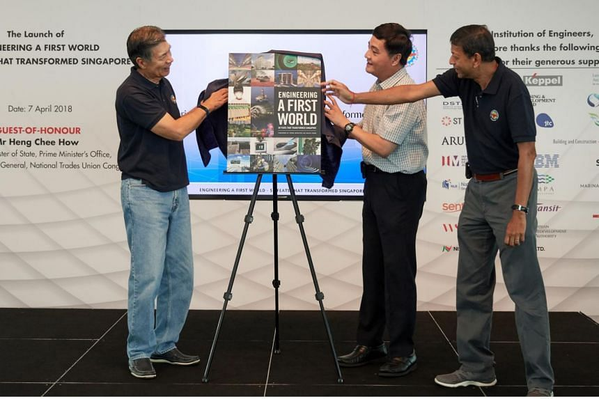 Senior Minister of State in the Prime Minister's Office Heng Chee How (centre) launching the book together with IES President Edwin Khew (left) and chairman of the book committee Mervyn Sirisena (right).