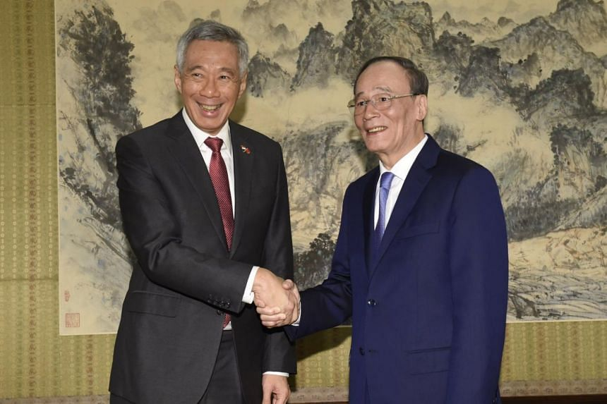 Prime Minister Lee Hsien Loong and Chinese Vice-President Wang Qishan exchanged warm pleasantries and handshakes when they met on April 9 at the Ziguang Ge (or Hall of Purple Light).