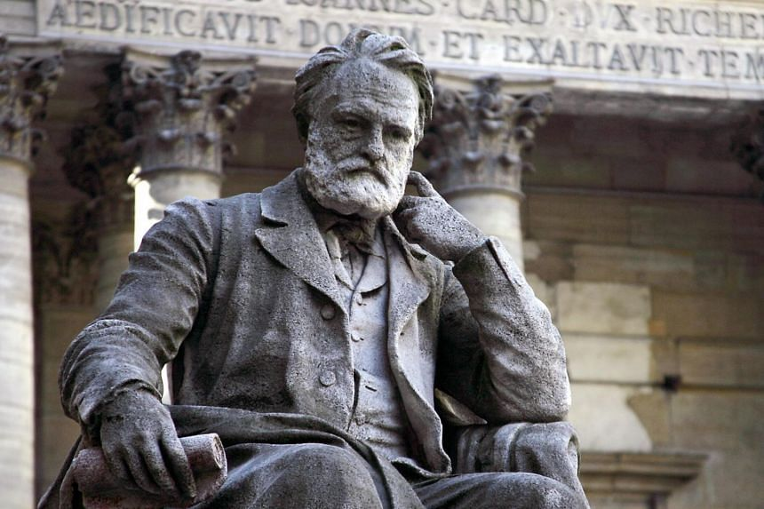 A statue of Victor Hugo near the chapel in the courtyard of the Sorbonne university in Paris.