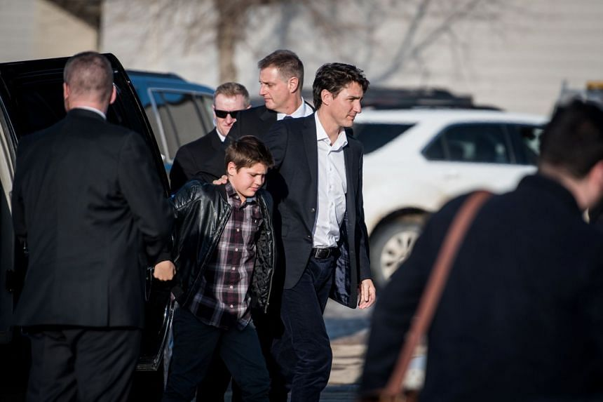 Canadian PM Justin Trudeau arrives with his son Xavier at the Elgar Petersen Arena to attend a vigil for members of the Humboldt Broncos, on April 8, 2018.