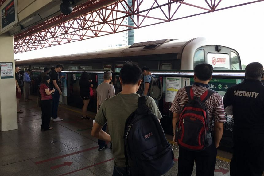 Commuters at Jurong East MRT station during a delay along a west-bound stretch of the East-West Line (EWL), on April 9.