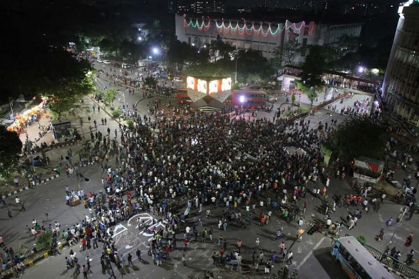 Bangladeshi university students block a road during a protest against the quota system used in government recruitment in Dhaka, on April 9, 2018.
