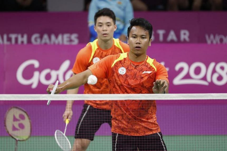 Danny Bawa Chrisnanta (front) and Terry Hee Yong Kai of Singapore in action during the men's doubles badminton match at the Commonwealth Games.
