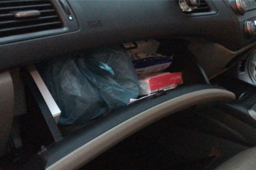 Heroin in glove compartment of car driven by 45-year-old Singaporean male suspect.