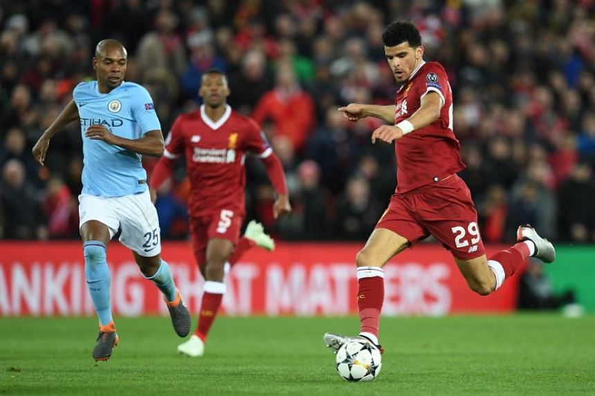 Liverpool striker Dominic Solanke controls the ball during the UEFA Champions League first leg quarter-final match against Manchester City at Anfield stadium on April 4, 2018.
