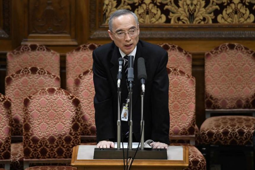 Mr Mitsuru Ota, head of the Finance Ministry's Financial Bureau, answers questions during a session of the upper house budgetary committee at parliament in Tokyo, on March 26, 2018.