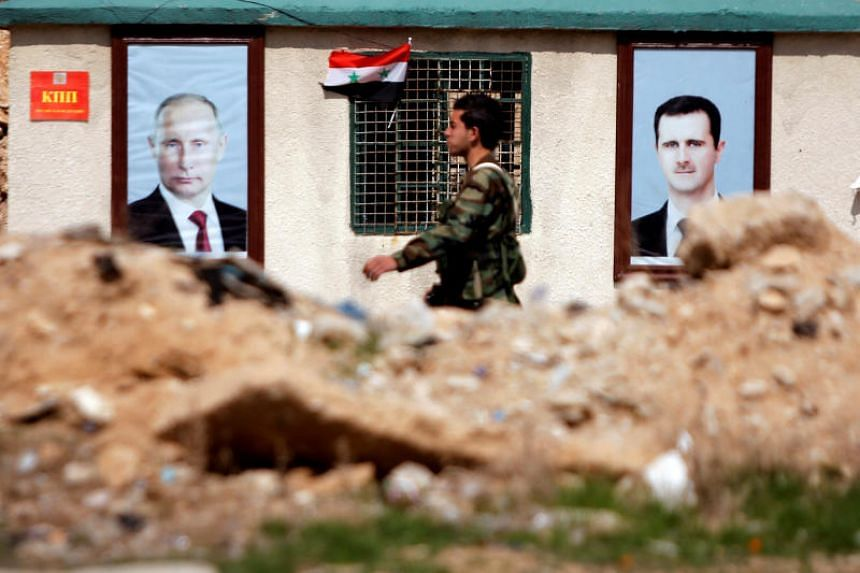 A Syrian soldier loyal to President Bashar al Assad is seen outside eastern Ghouta, in Damascus, Syria, on Feb 28, 2018.