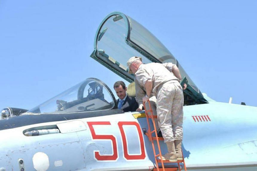 Syria's President Bashar al-Assad visits a Russian air base at Hmeymim, in western Syria in this handout picture posted on Sana, on June 27, 2017.