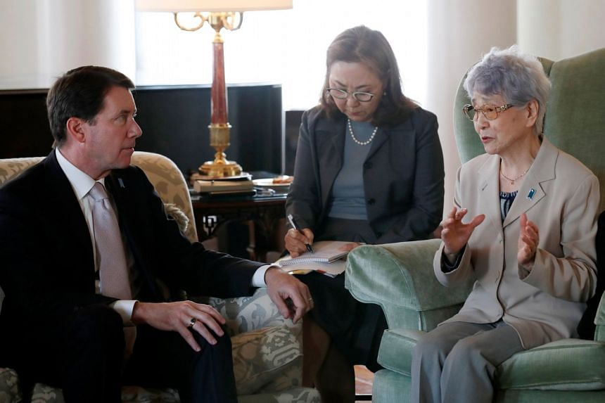 Sakie Yokota (right), whose daughter Megumi Yokota was abducted by North Korean agents in 1977, meets US ambassador to Japan William Hagerty in Tokyo, on April 10, 2018.