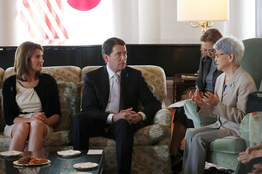 Sakie Yokota (right), whose daughter Megumi Yokota was abducted by North Korean agents in 1977, meets US ambassador to Japan William Hagerty and his wife Chrissy in Tokyo, on April 10, 2018.