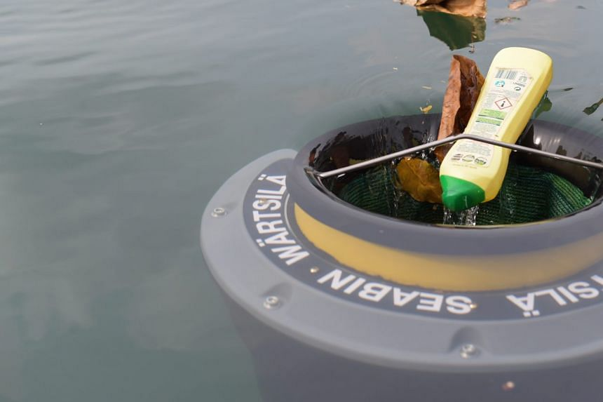 Trash and oil are pulled into the Seabin via its electric pump.
