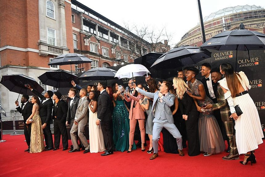 The stars of the West End version of the American musical Hamilton arrived with umbrellas at the ceremony at London's Royal Albert Hall on Sunday.