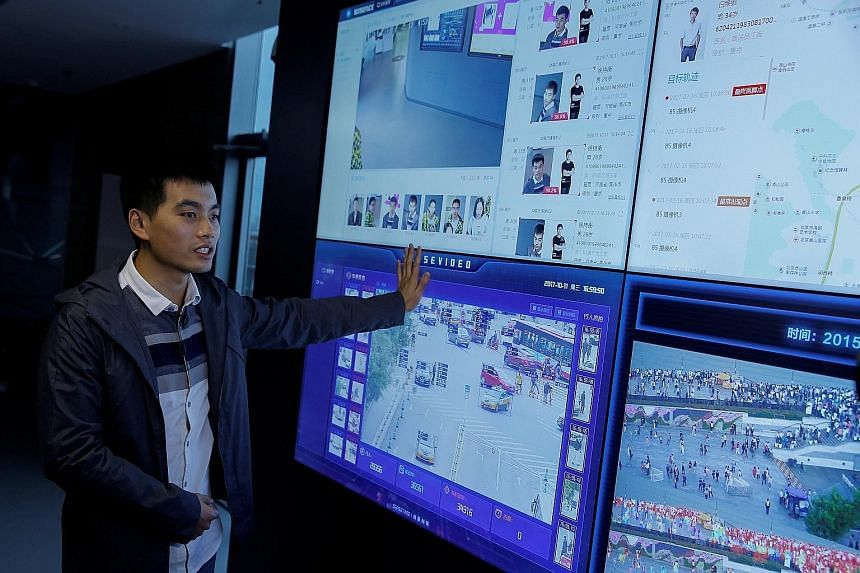 Co-founder Xu Chiheng with SenseTime's technology. The firm specialises in systems that analyse faces and images on a large scale.