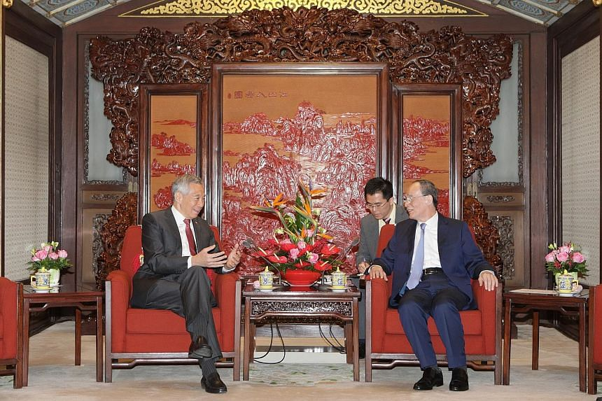 Prime Minister Lee Hsien Loong meeting Chinese Vice-President Wang Qishan in Beijing yesterday. PM Lee is on a five-day working visit to China.