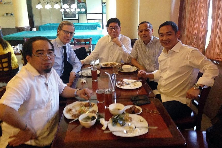 A 2015 photo showing (from left) Mr Joel Egco, Cambridge Analytica's Mr Alexander Nix, Mr Jose Gabriel La Vina and Mr Peter La Vina, who were part of the Duterte campaign team, and lawyer Taipan Millan.