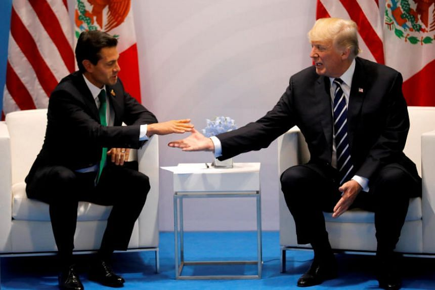 US President Donald Trump with Mexico's President Enrique Pena Nieto during the their bilateral meeting at the G20 summit in Hamburg, Germany on July 7, 2017.