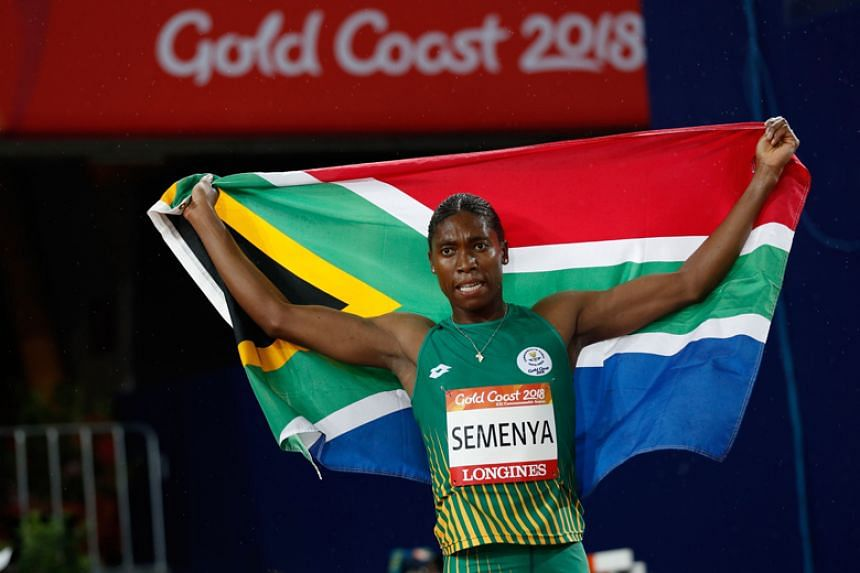 South Africa's Caster Semenya holds her national flag after winning the athletics women's 1,500m final during the 2018 Gold Coast Commonwealth Games at the Carrara Stadium on April 10, 2018.